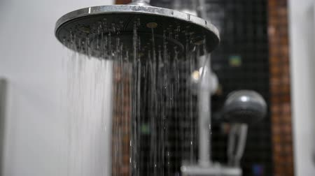 chróm : Close up of Water flowing from shower in the bathroom