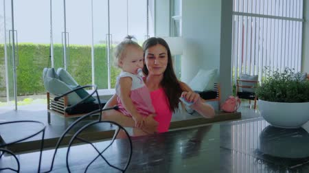 invité : Young girl, mom and daughter guests about check-in in hotel and giving key card from room to man . Business, travel and people concept Vidéos Libres De Droits
