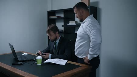 subordinate : two businessmen argue about signing a contract of documents in the office, the chief and subordinate, slow motion.