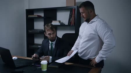 subordinate : two businessmen argue about signing a contract of documents in the office, the chief and subordinate, man throws documents, slow motion.