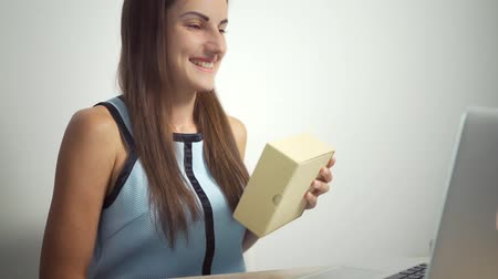 легкий : Shopping online concept. Woman holding a credit card and using laptop. female rejoices credit card. female gives the card online and gets the goods