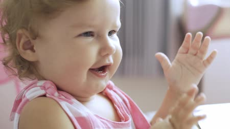 маленькая девочка : little beautiful girl claps her hands and rejoices at the achievement. concept of happiness, joy
