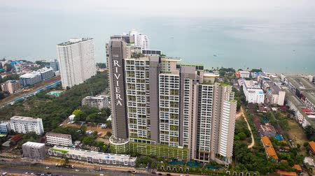 siamês : The Riviera Wongamat Hong Apartment, Pattaya, Thailand. Main Pattaya Bay view from above sunny day aerial view. Video. Beautiful landscape aerial view.