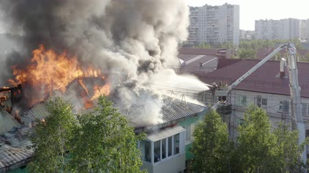 firetruck : Nizhnevartovsk, Russia - July 1, 2019: firefighters extinguish a fire on the roof of a residential highrise building. top view.