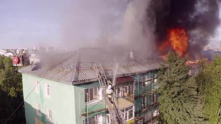 megelőzés : Burning roof of a residential high-rise building, clouds of smoke from the fire. top view.