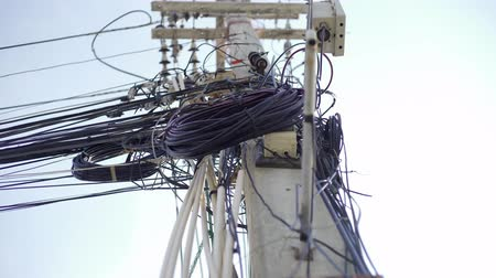 csatolt : Messy wires attached to the electric pole, the chaos of cables and wires on an electric pole Thailand, concept of electricity Stock mozgókép
