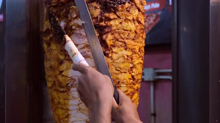chawarma : Shawarma. Closeup picture of stacked meat roasting, shawarma