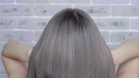 szampon : Result after lamination and hair straightening in a beauty salon for a girl with brown hair. hair care concept.
