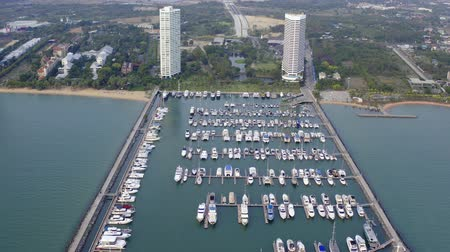 lancha : Aerial View by Drone of Yacht Club and Marina. Top view of yacht club. White boats in sea water. Marina dock yachts and small moto. Yacht and sailboat.