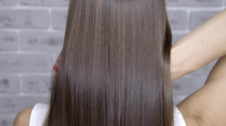 conditioner : Result after lamination and hair straightening in a beauty salon for a girl with brown hair. hair care concept.