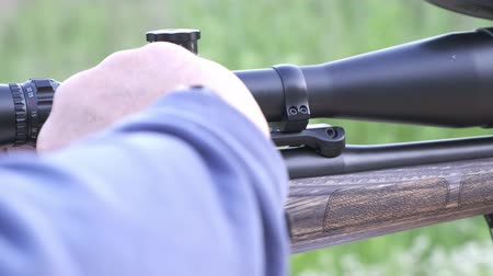 ear protection : male shoots with a firearm, shotguns outdoors