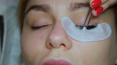 kiterjesztés : Eyelash Extension Procedure. Woman Eye with Long Eyelashes. Lashes, close up.