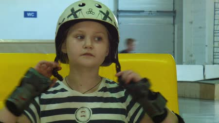 helmets : the girl puts on a roller suit
