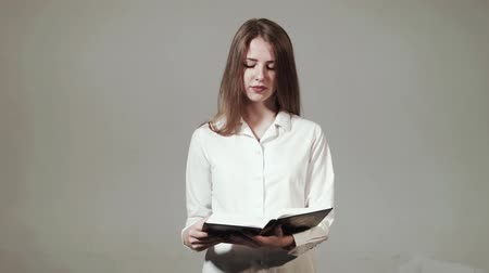 biblia : Young Christian girl reads the Bible HD Stock mozgókép