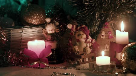 arife : Candles balls and bears on the table Christmas atmosphere Stok Video