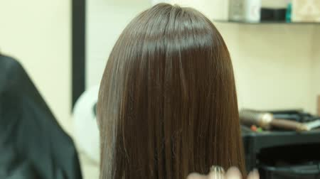 dryer : The hairdresser dries hair Stock Footage