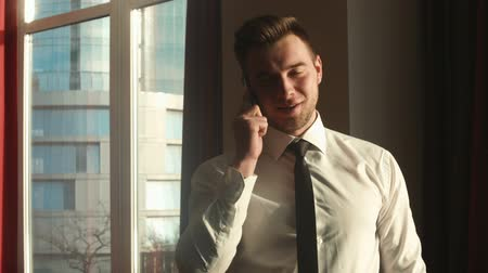 counsel : Stylish businessman talking on the phone