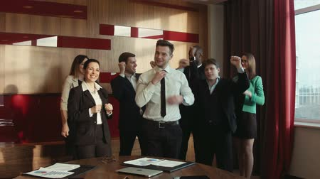 сотрудники : Group of successful businessmen happy Стоковые видеозаписи