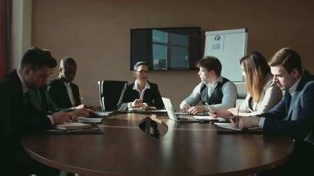 boss : a group of businessmen at business meeting