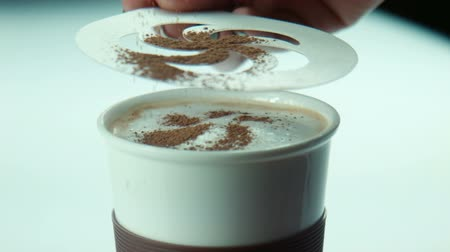 mırlamak : Female makes coffe art pattern with sheet, female pur the cocoa on the coffee foam. Latte Art Coffee Hot Drink Decoration Scented Melting Sheet