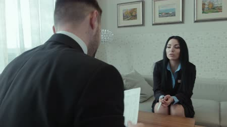 agreement : Dialog of the businessman and female hotel staff manager or consultant in the hall of the hotel, discussing some papers Stock Footage