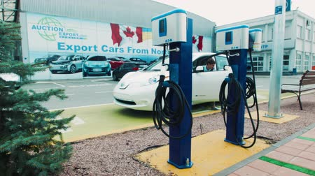 recharging : Depot for recharging electric cars with two digital charging points in an urban environment conceptual of eco friendly transport
