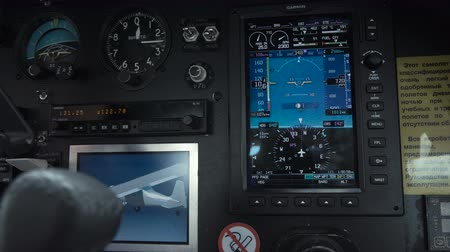ZAPOROZHYE, UKRAINE - October 10, 2017: Video clip of pilot flying aircraft closeup of hands on cockpit controls