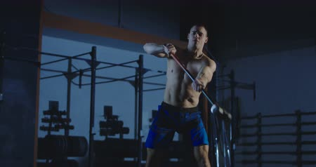 Man exercising with hammer during crossfit training at gym. Slowmotion shot on Red cinema camera. Slow motion 4K shot on Red cinema camera.