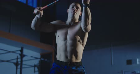 Close view of man exercising with hammer during crossfit training at gym. Slowmotion shot on Red cinema camera.