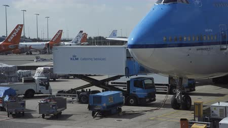 Paris, France - October 18, 2018: View of modern blue klm jumbo jet being loaded with luggage and cargo before flight in airport