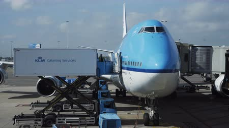 Paris, France - October 18, 2018: View of modern blue jumbo jet being loaded with luggage and cargo before flight in airport