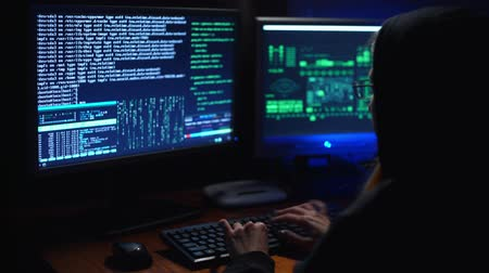 scammer : a girl hacker cracks a password Stock Footage