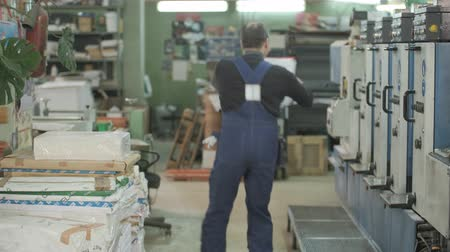 stock raising : Working printing waltzes along the printing press after the change Stock Footage