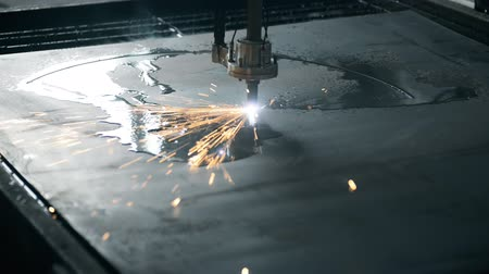 sheet : Industrial machine CNC plasma laser cutting processing manufacture technology passes through the border flat sheet metal steel material with more many sparks a given computer, lot of bright sparks, smoke and light. The step of cutting parts. the machine b Stock Footage