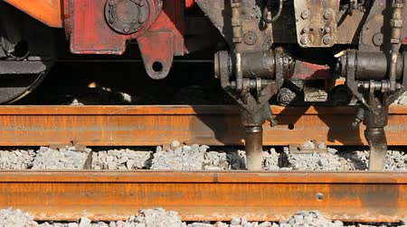 macadam : A tamping machine is a machine used to pack the track ballast under railway tracks
