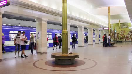 approaching subway : ST PETERSBURG - JUNE 20: Timelapse of commuters enter and exit a subway train at station Sportivnaya, June 20, 2011, St. Petersburg, Russia. The Saint Petersburg Metro is the deepest subway system in the world by the average depth of all the stations. Stock Footage