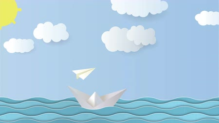fırtına : 4K paper animation and sootage background. Waves are swaying, a paper boat is floating, an airplane is flying, clouds are moving, the sun is shining.