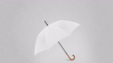 meteorologia : Rain with umbrella on grey background animation. Umbrella protects from snow or rain, rain, weather 4K animation video footage. Stock Footage