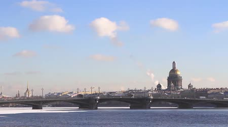 Time lapse of Neva river bridge and St Isaacs Cathedral at winter. St. Petersburg, Russia