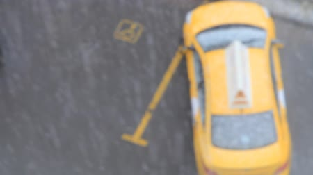 hd taxicab is waiting passengers snow is falling. blurred video