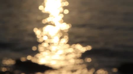 Abstract hd video of sea sunset. Blurred warm bokeh sparks Wideo
