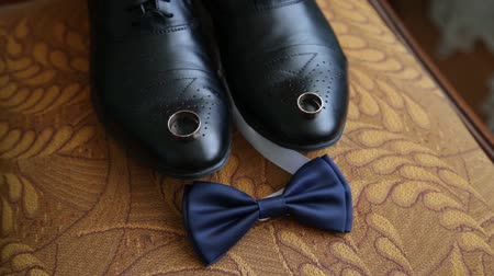 tying : Business man dressing up with classic, elegant shoes. Groom wearing shoes on wedding day, tying the laces and preparing. Black and white photo