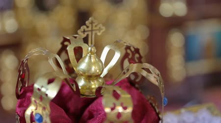communion : Newlyweds wedding precious crown in church. Stock Footage