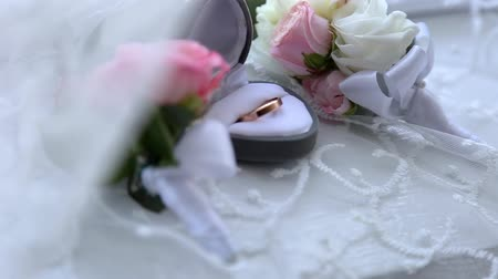 wedding and gold : Two gold rings in a box for rings at the wedding Stock Footage