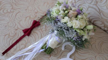 bridal bouquet posy with rings. groom boutonniere