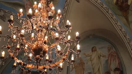 Big bronze chandelier in cathedral christian church