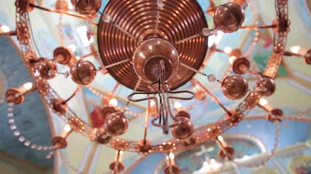 kutsal : Big bronze chandelier in cathedral christian church