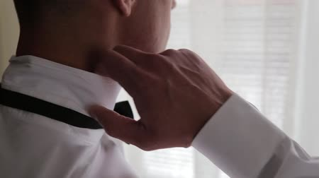 sleeve : elegant young fashion man looking at his cufflinks while fixing them Stock Footage