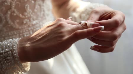 romance : The bride puts a wedding ring on her finger