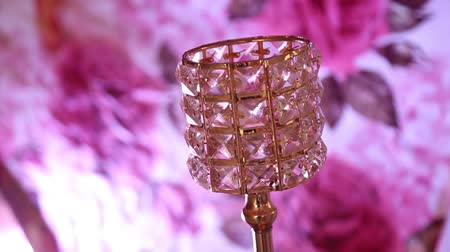 drahokamy : A close photo of a table lamp with pendants in the form of transparent faceted crystals. Luxury lamp.